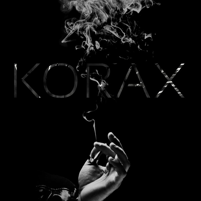 KORAX - Black Suit At A White Party